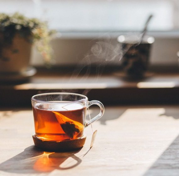 This is a stock photo of tea brewing in front of a sunny window